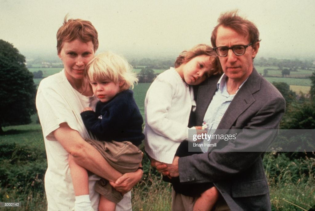 American actor Mia Farrow and her partner, American film director, writer, and actor Woody Allen, hold their children, Satchel (L) and Dylan, on a hill top while on vacation in Ireland.