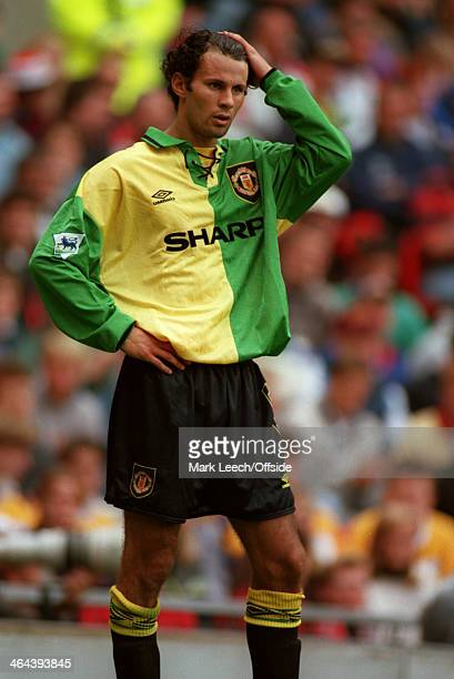 31 July 1993 Friendly football match Manchester United v Benfica Ryan Giggs wearing the green and yellow United change kit