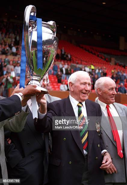 31 July 1993 Manchester United v Benfica Ex Manchester United manager Sir Matt Busby holds the Champions League trophy aloft