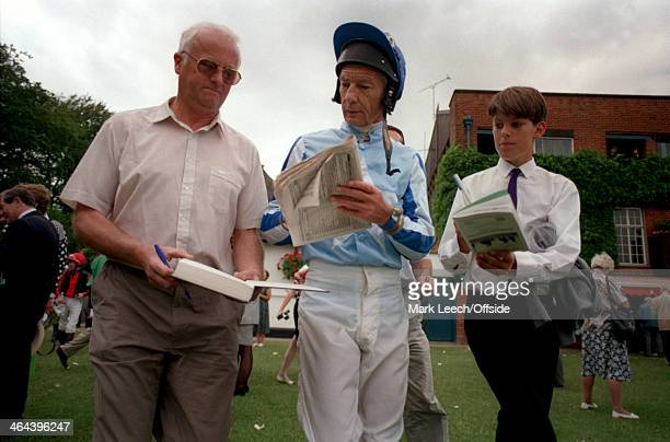 07 July 1993 Newmarket Races Lester Piggott is surrounded by fans young and old wanting his autograph