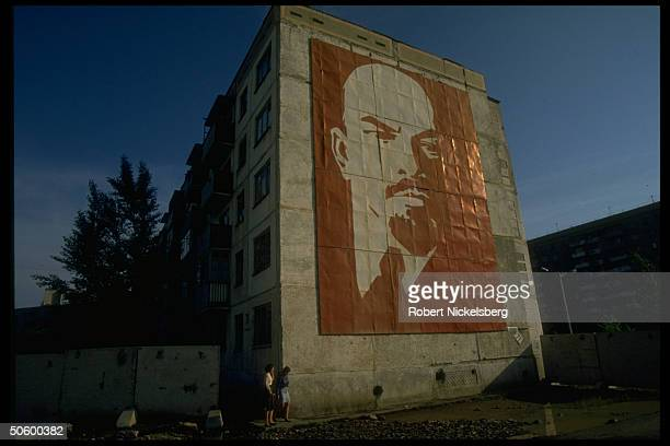Street mural of Lenin towering above passersby in Central Steppes region city Ekibastuz