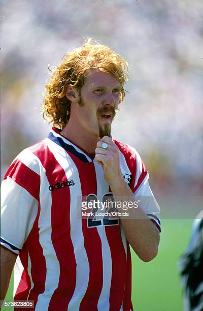04 July 1994 Fifa World Cup Brazil v USA Alexi Lalas of USA reflects on the defeat by tugging his beard