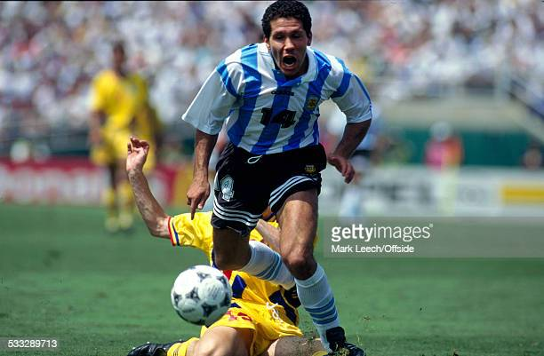 July 1994 - Fifa World Cup - Romania v Argentina - Diego Simeone of Argentina is tackled.