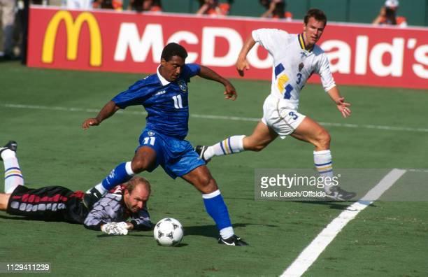 July 1994, FIFA World Cup Semi Final, Pasadena, Brazil v Sweden: Romario of Brazil rounds Sweden goalkeeper Thomas Ravelli and shoots at goal.
