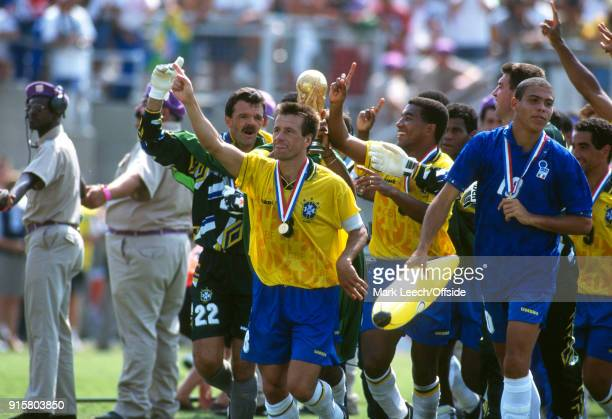 FIFA World Cup Final Brazil v Italy Brazilian captain Dunga carries the trophy as Ronaldo carries an inflatable banana