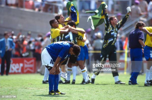 FIFA World Cup Final Brazil v Italy Roberto Baggio hangs his head after missing the vital penalty during the shootout and Brazilian players celebrate