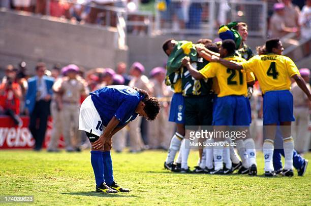 17 July 1994 World Cup Final 1994 Brazil v Italy Los Angeles Roberto Baggio has his hands on his knees in despair as the Brazilian team celebrate his...