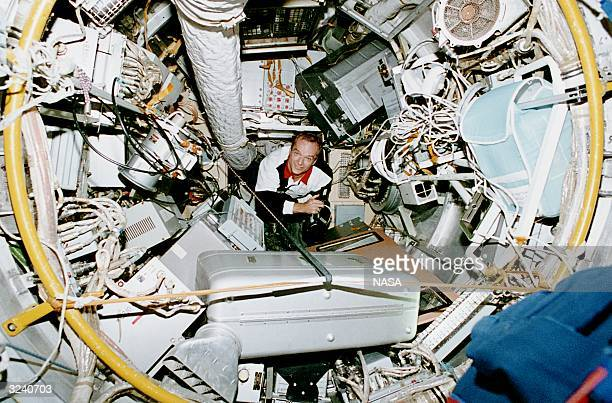 STS71 pilot Charles J Precourt crosses from the Atlantis shuttle into Kristall which houses the docking port of the Russian space station Mir