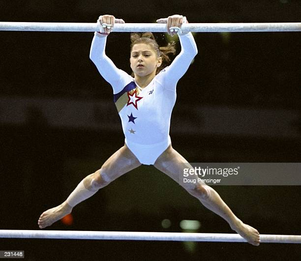 Dominique Moceanu of the USA in action during the women''s team compulsories at the Georgia Dome at the 1996 Centennial Olympic Games in Atlanta...