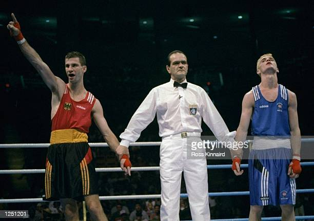 Falk Huste left of Germany defeats David Burke right of Great Britain at Alexander Memorial Coliseum of Georgia Tech University at the 1996...