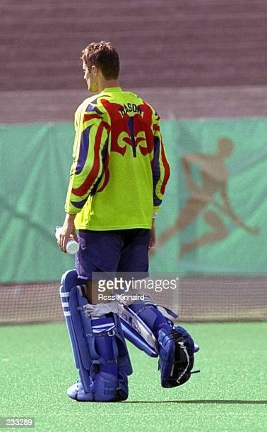 Great Britain goalkeeper Simon Mason walks off dejected after their defeat by Australia during the 1996 Centennial Olympic Games at the Morris Brown...