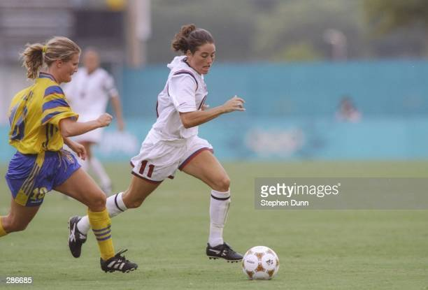 Julie Foudy of the USA women soccer team runs after the ball during game against Sweden at the Citrus Bowl in Orlando, Florida during the Olympic...