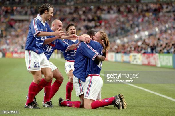12 July 1998 FIFA World Cup Final France v Brazil Emmanuel Petit celebrates on his knees after scoring the third goal for France and is embraced by...