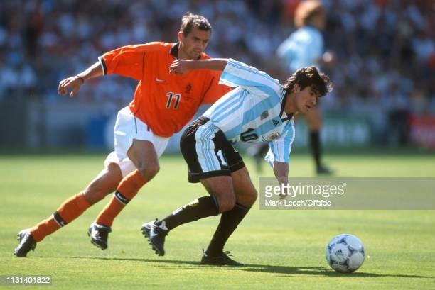 4 July 1998 FIFA World Cup Quarter Final Stade Veldorome Netherlands v Argentina Ariel Ortega of Argentina attempts to escape Philip Cocu of the...