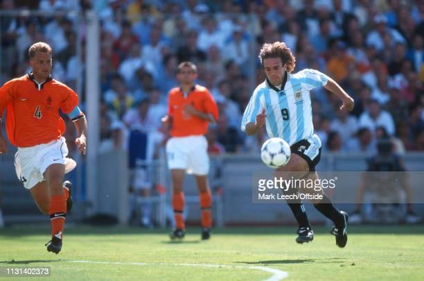 4 July 1998 FIFA World Cup Quarter Final Stade Veldorome Netherlands v Argentina Gabriel Batistuta of Argentina drives forward past Frank de Boer of...