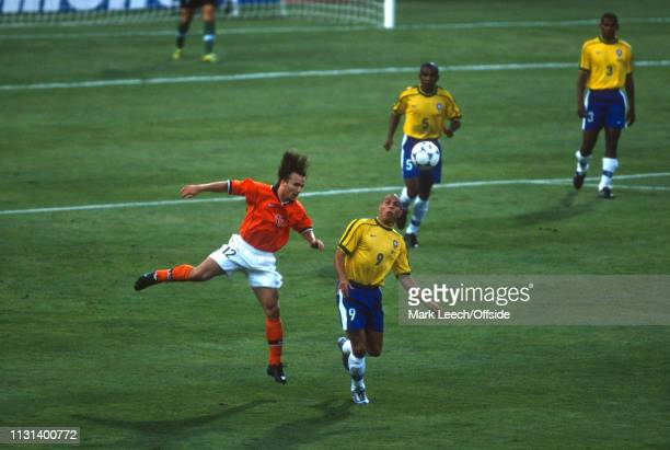 July 1998 - FIFA World Cup - Semi Final - Stade Velodrome - Brazil v Netherlands - Boudewijn Zenden of the Netherlands heads the ball away from...