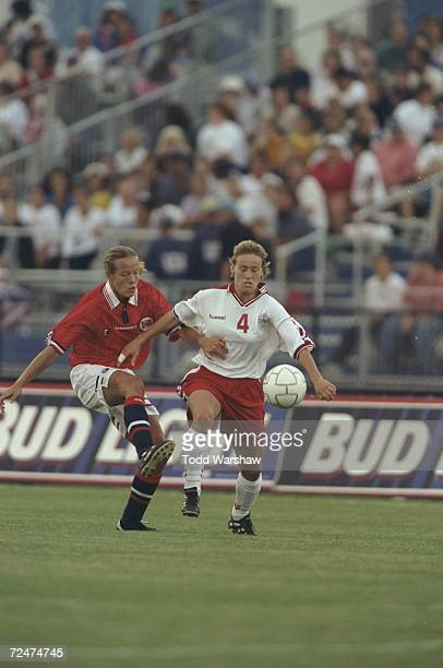 Joanne Axelsen of Team Denmark fights for the ball with Marianne Pettersen of Team Norway during the Goodwill Games womens soccer match at the...