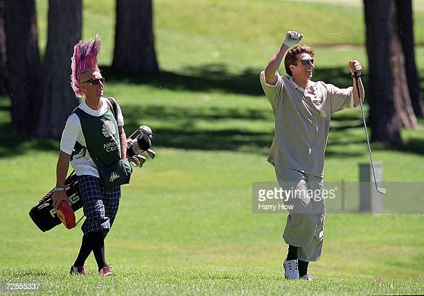 Gold medalist skier Jonny Moseley with caddie Glen Plake during the Celebrity Golf Campionships at the Edgewood Tahoe Golf Course in Stateline Nevada...