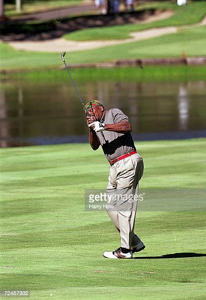 Jim Brown watches the ball after hitting it during the Celebrity Golf Campionships at the Edgewood Tahoe Golf Course in Stateline Nevada Mandatory...