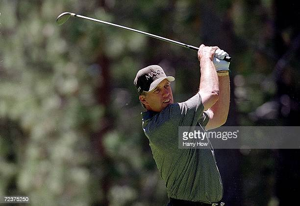 John Elway watches the ball after hitting it during the Celebrity Golf Campionships at the Edgewood Tahoe Golf Course in Stateline Nevada Mandatory...
