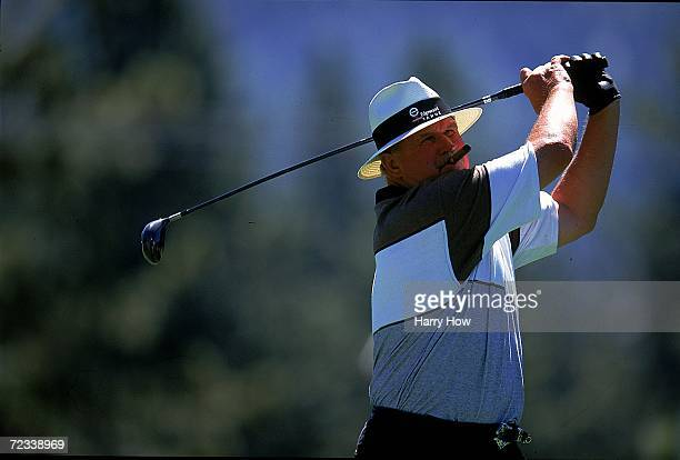 Mike Ditka watches the ball after hitting it during the Celebrity Golf Campionships at the Edgewood Tahoe Golf Course in Stateline Nevada Mandatory...