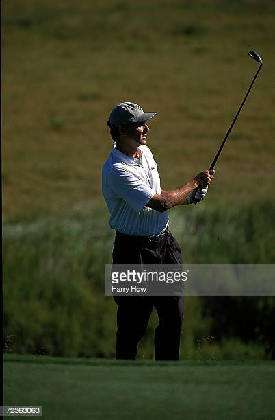 Rick Pitino watches the ball after hitting it during the Celebrity Golf Campionships at the Edgewood Tahoe Golf Course in Stateline Nevada Mandatory...