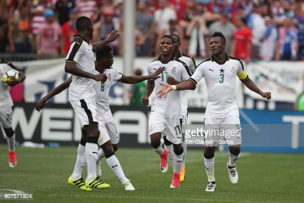 Asamoah Gyan of Ghana celebrates with team mates after scoring a goal during the United States Vs Ghana International Soccer Friendly Match at Pratt...