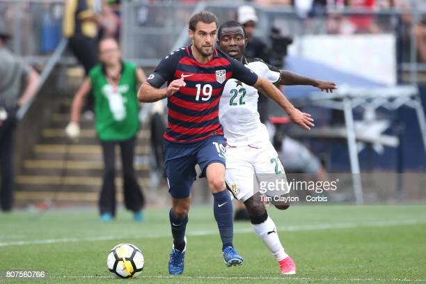 Graham Zusi of the United States is challenged by Frank Acheampong of Ghana during the United States Vs Ghana International Soccer Friendly Match at...