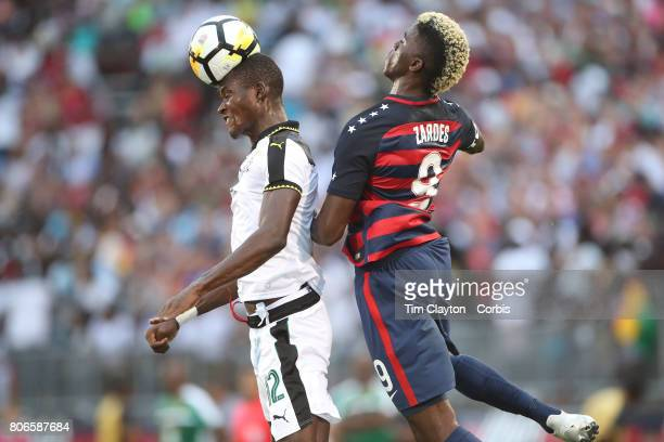 Samuel Sarfo of Ghana is challenged by Gyasi Zardes of the United States during the United States Vs Ghana International Soccer Friendly Match at...