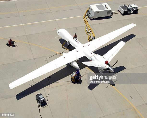july 2, 2008 - ground crewmen prepare the ikhana remotely piloted research aircraft for another flight. ikhana's infrared imaging sensor pod is visible under the left wing.  - military drones stock photos and pictures