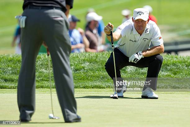 Alex Cejka watching as Charley Hoffman lines up his putt on 17 during the second round of the AT&T National at Aronimink Golf Club in Newtown Square,...