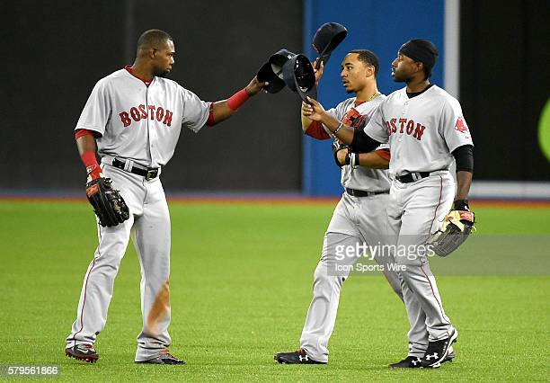 July 2, 2015; Toronto, ON, Canada: Boston Red Sox outfielders , Alejandro De Aza , Mookie Betts , and Jackie BradleyJr. Celebrate a 12-6 win over...