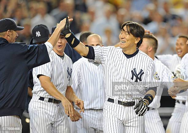 New York Yankees Vs Baltimore Orioles at Yankee Stadium Bronx NY Yankees Hideki Matsui with a walk off homerun in the ninth inning Matsui get a pie...