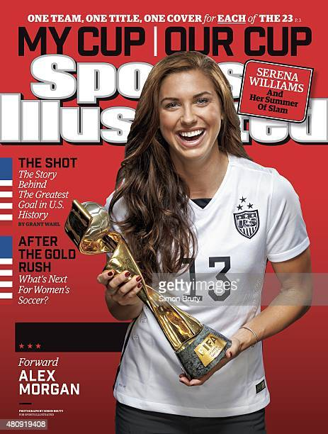 Soccer FIFA World Cup Champions Portrait of US Women's National Team forward Alex Morgan holding trophy during photo shoot at ABC News' Good Morning...