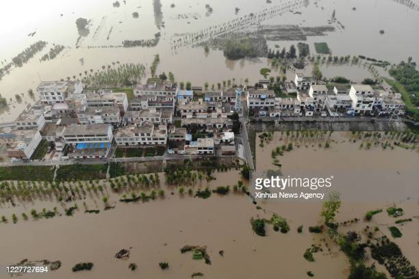 July 20, 2020 -- Aerial photo shows Zhengtaizi embankment in Mengwa flood storage area in Funan County, east China's Anhui Province, July 20, 2020....
