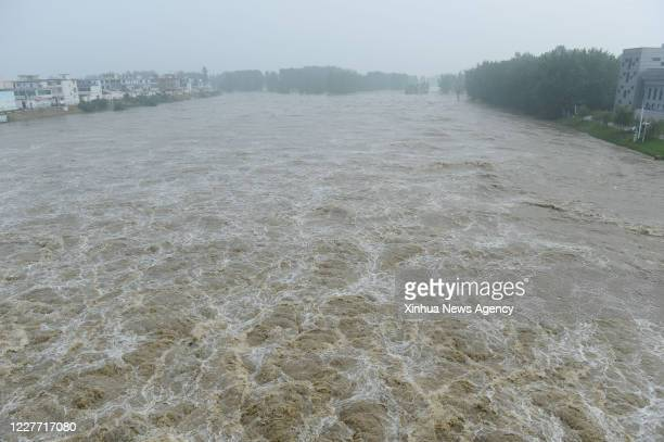July 20, 2020 -- Floodwater from the Huaihe River are diverted into the Mengwa Flood Detention Area in Funan County, east China's Anhui Province,...