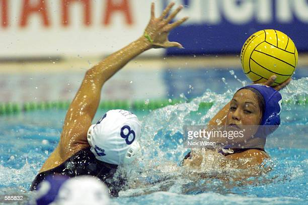 Brenda Villa of the USA takes her shot during the Womens Water Polo first round match between USA and Italy which finished in a 88 draw at the Nishi...