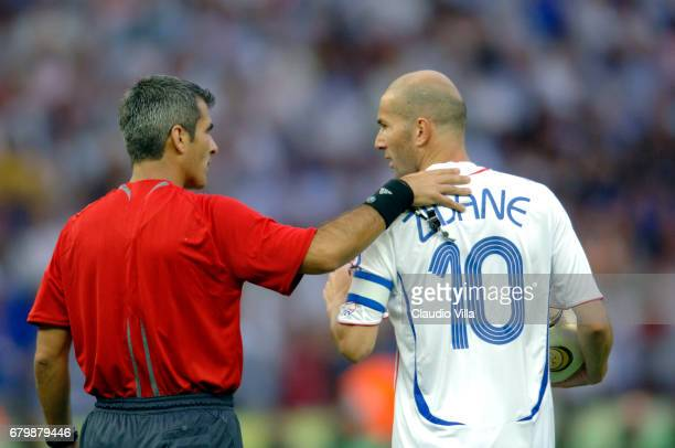 09 july 2006 Zinedine ZIDANE AND THE REFEREE Horacio Elizondo during the World Cup 2006 final match between Italy and France played at Olympic...