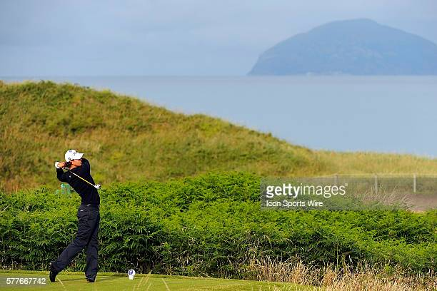 Adam Scott watches his tee shot on the second hole with Ailsa Craig Island in the background during the first round of the 138th OPEN Championship...