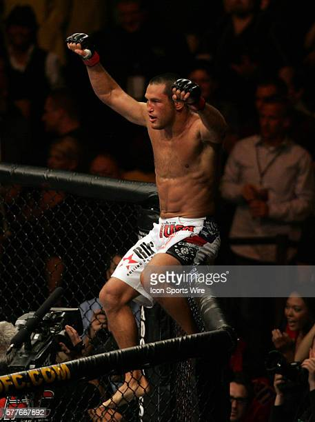 Dan Henderson sits atop the octagon and celebrates his knockout victory over Michael Bisping of Britain after their UFC 100 event at the Mandalay Bay...