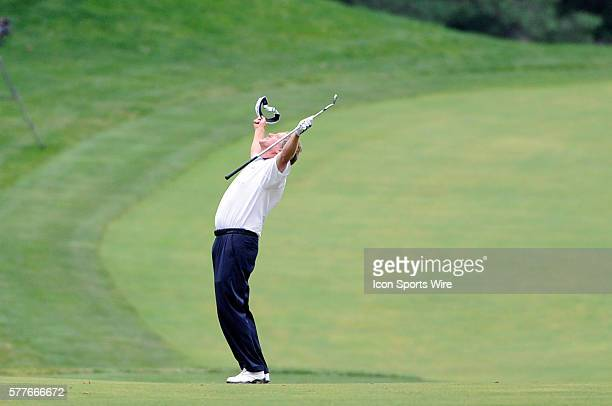 Michael Allen raises his arms after hitting his third shot from the fairway 145 yards for an eagle on the 9th hole in the final round of the AT&T...