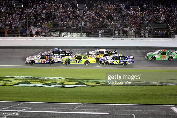 Tony Stewart , Denny Hamlin , Matt Kenseth , Elliott Sadler , and Jimmie Johnson pass the start finish line heading toward turn 1 during the Sprint...