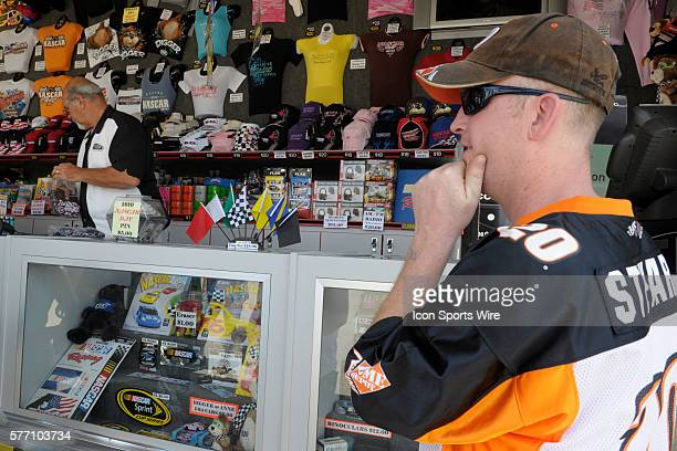 A fan decides on a purchase on the midway of ChicagoLand Speedway prior to the start of the NASCAR Sprint Cup Series LifeLockCOM