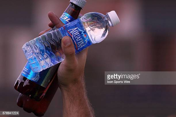 A vendor in the stands displays the water and beer he is selling during the Frontier League All Star Baseball game at Corn Crib Stadium on the campus...
