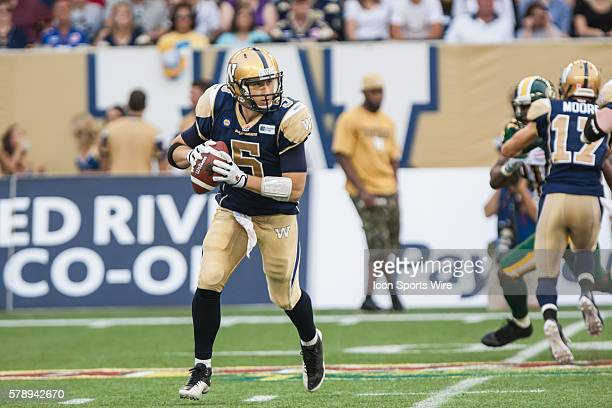 July 2014 Blue Bombers Drew Willy runs with the ball during the Eskimos vs Bombers game at the Investors Group Field in Winnipeg MB.