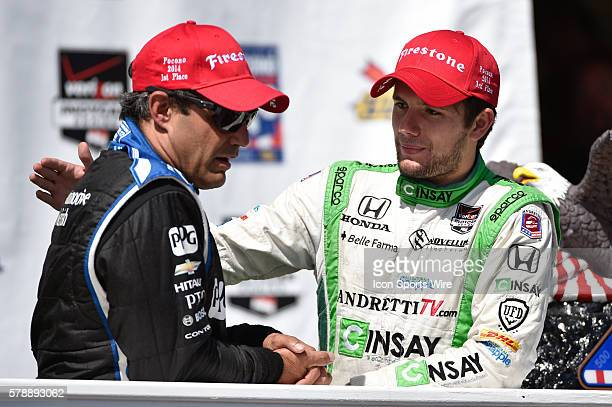 Carlos Munoz congratulates Juan Pablo Montoya after the Pocono 500 at Pocono Raceway in Long Pond PA