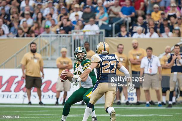 July 2014 Eskimos Mike Reilly goes back to pass during the Eskimos vs Bombers game at the Investors Group Field in Winnipeg MB.