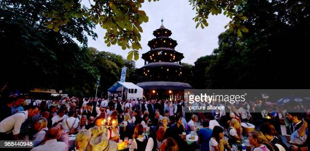 Countless visitors of the traditional Kocherlball sitting by the beer tables at the Chinese Tower in the English garden Once a year the British...