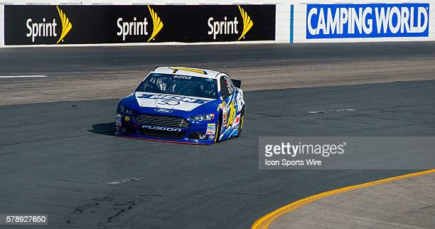 Greg Biffle hits the track in his NESN 30th Anniverary Fusion Ford during practice for the Camping World RV Sales 301 at New Hampshire Motor Speedway...