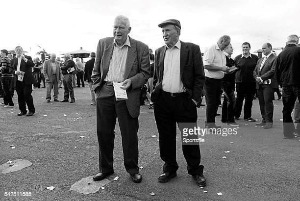 28 July 2014 Joe Stapleton left from Ennis Co Clare and Pat Furey from Oranmore Co Galway look up the betting prices ahead of the Pillo Hotel...